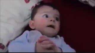 عکس العمل نوزاد هنگام شنیدن تلاوت قران و موزیک